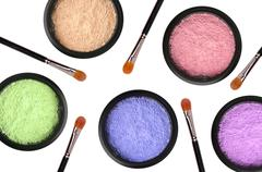 multicolored cosmetics eyeshadows in the box and brushes isolated on white - stock photo