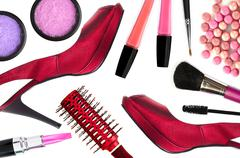 Cosmetics (make-up products) and red woman shoes isolated on white background Stock Photos
