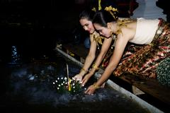 Traditionl Thai Woman Releasing Krathong at the Loi Krathong Festival in Bangkok - stock photo