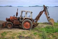 Tractor on the seashore Stock Photos