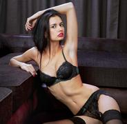 Beautiful brunette in black underwear Stock Photos