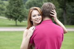 Stock Photo of happy beautiful girl hugging her favorite guy