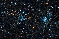 starfield. a double star cluster in perseus - stock photo