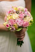 Stock Photo of Bride is holding a bouquet of flowers