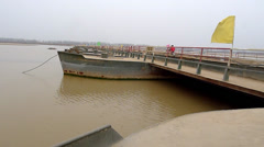 The yellow river, flowing peacefully through a pontoon bridge in the winter Stock Footage