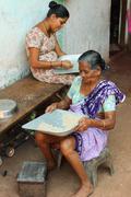 Indian women and rice Stock Photos