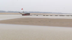 The yellow river, flowing peacefully in the winter, and the boat in a harbor Stock Footage