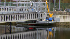 Waste water plant clarifier tank and skimmer Stock Footage