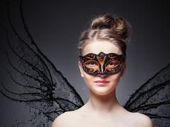 girl in masquerade mask - stock photo