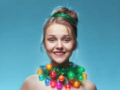 Christmas funny portrait of a young girl Stock Photos
