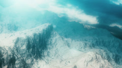 Aerial shot of a gorgeous snow-capped mountain range. - stock footage