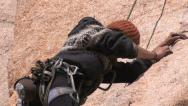 Stock Video Footage of Female Rock Climber 3 in series