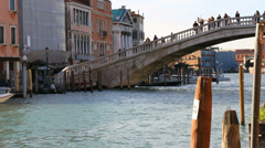 Two rowers towards Venice bridge Stock Footage