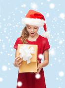 smiling girl in santa helper hat with gift box - stock illustration