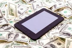 Tablet pc over dollars Stock Photos