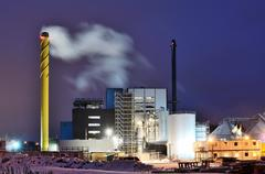 power station at night in winter - stock photo