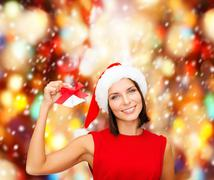 Stock Illustration of woman in santa helper hat with jingle bells