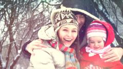 Winter family having fun outdoors Stock Footage