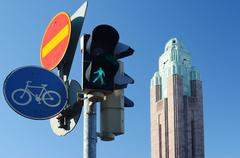 traffic lights and road signs against sky - stock photo