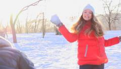 Young couple throwing a snowballs outdoors - stock footage