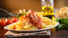 Pasta Penne with Bolognese Sauce, Parmesan Cheese and Basil - stock footage