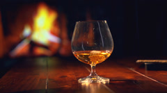 Cognac. Pouring Brandy from a Bottle to a Glass Stock Footage