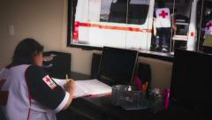 Female volunteer in red cross Stock Footage