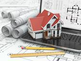 Stock Illustration of laptop, house and blueprint with project.