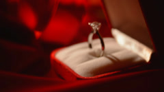 Diamond ring on red silk background Stock Footage