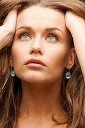 eautiful calm woman with beautiful earrings - stock photo