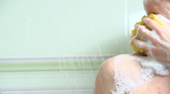 Shower. Young woman taking a shower - stock footage