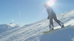 SLOW MOTION: Snowboarding down the ski slope Stock Footage