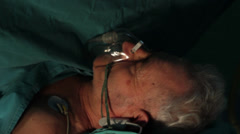 Patient lying on hospital table during surgical operation. Close up head. Stock Footage