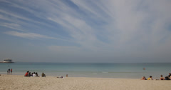 Ultra HD 4K People Swimming Relaxing Walking Dubai Jumeirah Beach Burj Al Arab Stock Footage