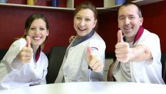 Care attendants holding thumbs up Stock Footage