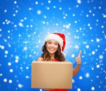 Stock Illustration of smiling woman in santa helper hat with parcel box