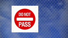 Caution sign - Do not pass on chain link fence Stock Footage