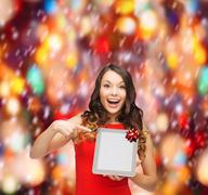 Stock Illustration of smiling woman in red dress with tablet pc