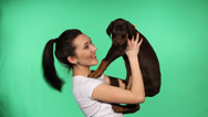 Stock Video Footage of Brunette girl with her dog
