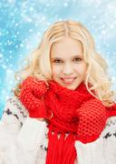 Stock Illustration of smiling teenage girl in red mittens and scarf