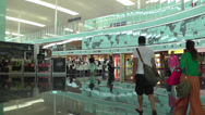 Stock Video Footage of Barcelona Airport central shopping area from concourse