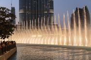 Stock Photo of night view dancing fountains downtown and in a man-made lake in dubai