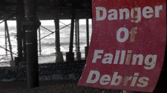 DANGER SIGN - FALLING DEBRIS - Ungraded Stock Footage