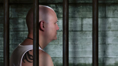 Prisoner in old jail cell camera track right Stock Footage