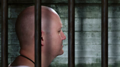 Prisoner in an old jail cell dramatic zoom in 3 Stock Footage