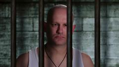 Prisoner in an old Jail cell dramatic zoom in Stock Footage