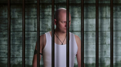 Prisoner in an old jail cell - stock footage