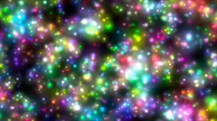 Flying through multitude of saturated colorful glowing stars in a rich starfield - stock footage