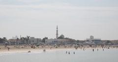 Ultra HD 4K Maharba Mosque Dubai Skyline Jumeirah Beach People Swimming Exotic Stock Footage