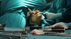 Surgeons team performing operation in hospital operating room, tools close up. Stock Footage